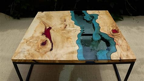 Get a live edge piece of wood, cut it in half, build a form, pour the resin, remove the form…easy peasy. SOLD Live edge river coffee table with red epoxy inlay SOLD