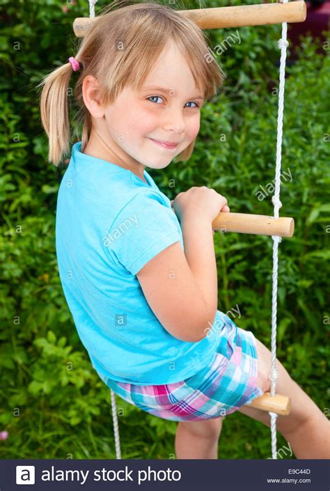 cute ls for girls portrait of cute little playing at monkey bars stock