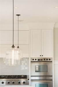 Glass pendant lights over kitchen island : A lovely melbourne kitchen with striking iron glass