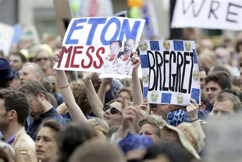 People hold banners during a demonstration against Britain ...