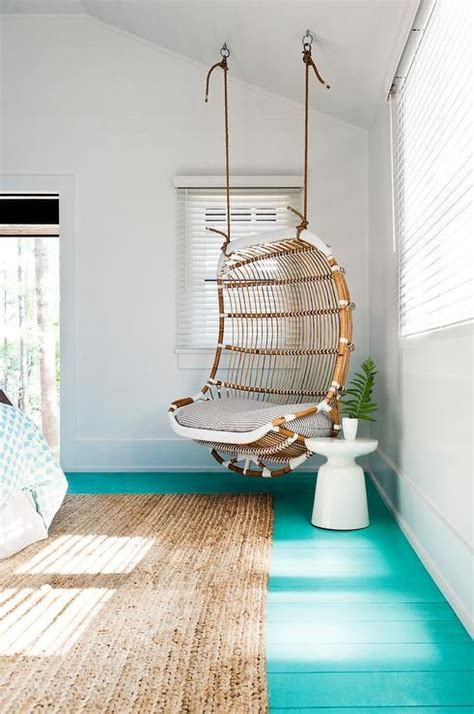 beach style girls bedroom boasts  corner rattan chair suspended   ceiling