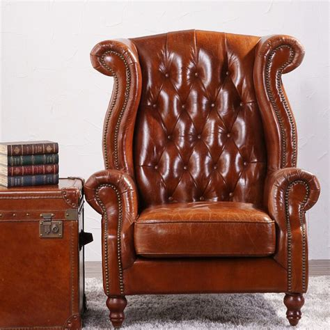 deconstructed studded high back leather wing chair view