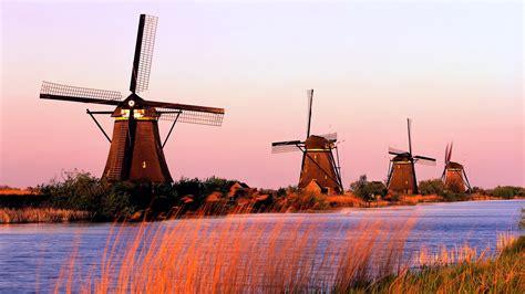full hd wallpaper netherlands river windmill sunset
