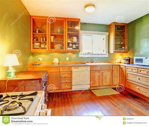 green kitchen  wood cabinets stock photo image