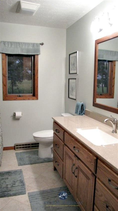 bathroom with oak vanity oak trim and door benjamin mist m e design and