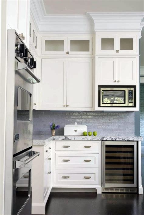 white kitchen  blue backsplash  roman shade