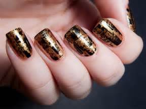 Sensational and sumptuous gold black nail art designs