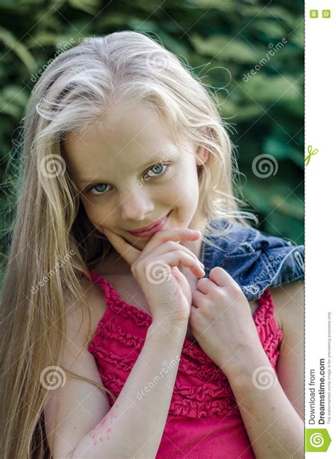 Portrait Of A Beautiful Blonde Little Girl With Long Hair
