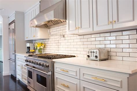 Kitchen Backsplash With Light Cabinets by Light Gray Kitchen Cabinets With Gold Hardware