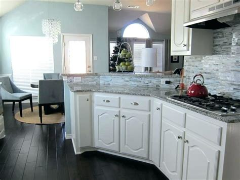 White Cabinets With Wood Floors Traditional Kitchen With