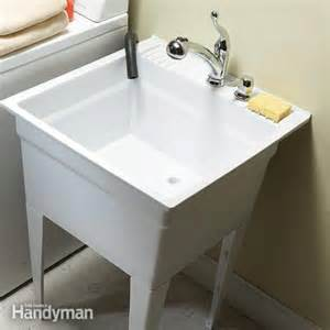 install new kitchen faucet upgrade your laundry sink the family handyman