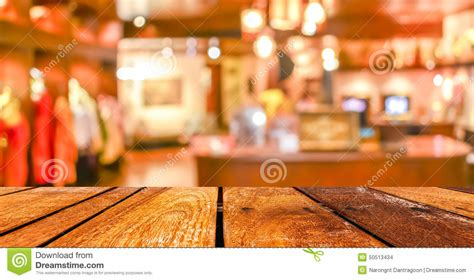 empty wood table  coffee shop blur background