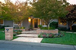 Front yard landscape contemporary with woven black granite