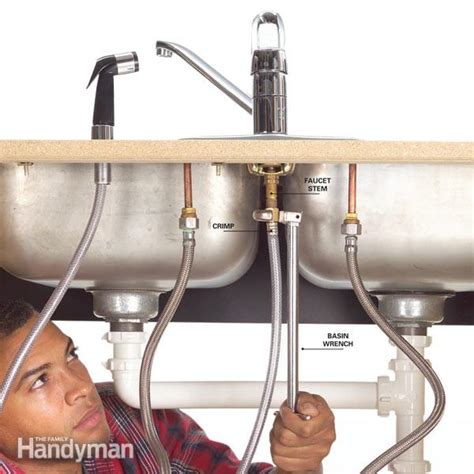 changing kitchen sink faucet how to fix a leaking sink sprayer the family handyman