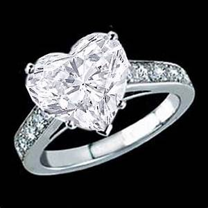 Engagement ring heart shape diamond cathedral engagement for Diamond heart wedding ring
