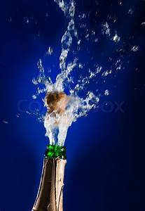 Close Up Of Champagne Cork Popping On Blue Background