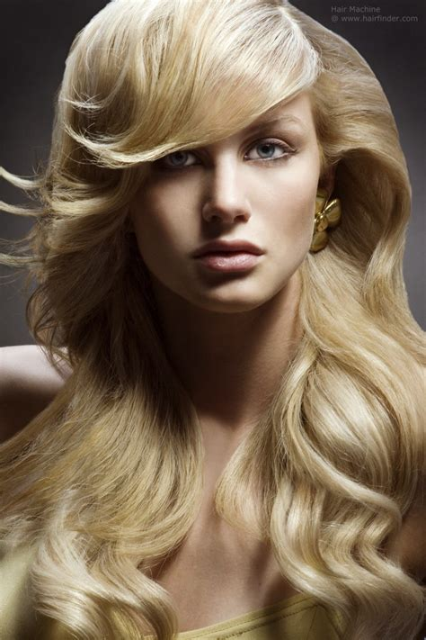 long flowing blonde hair styled  smooth cascading waves