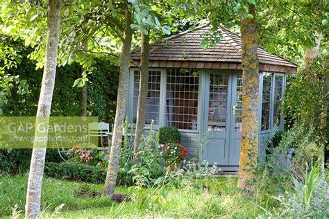 Gap Gardens-grey Summer House In Corner Of Small Garden