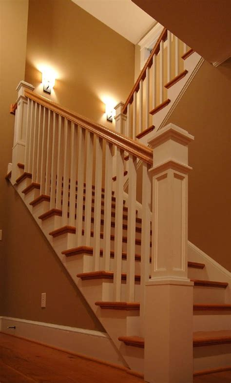 Banister Attachment by Painted Newel Posts And Rails Stained Treads And Handrail