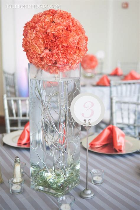 tall coral centerpiece with curly willow Coral wedding