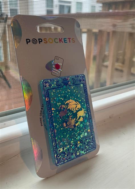 It's been hard yards you've been travelling these past few months, but finally conclusion is reached, closure is achieved and you'll be feeling as if the sun is finally shining upon you and life is rich and fun. Pisces tarot card Popsocket. The little fish were made ...