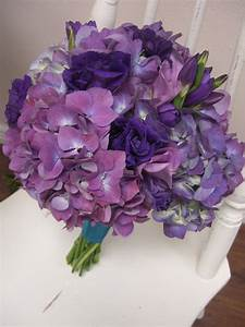 bouquet primarily of hydrangea with various purple ...