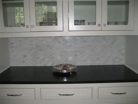 white cabinets with black granite white spring granite with tile backsplash home design ideas