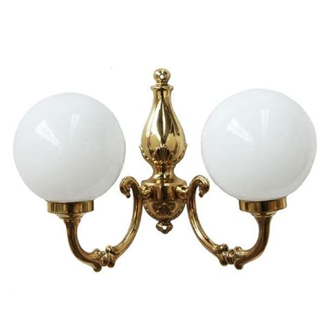 traditional globe wall light style wall light in gold brass with opal