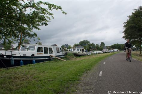 Bootje Aan De Amstel by De Amstel Buiten De Stad
