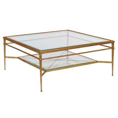 Its geometric shapes and bright colors will add a decorative touch to your interior. Maddy Square Gold Cocktail Table - Luxe Home Company
