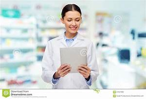Smiling Female Doctor With Tablet Pc At Drugstore Stock ...