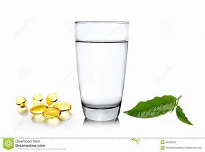 Glass Of Water Wiith Green Tea Leaf And Fish Oil On Whi ...