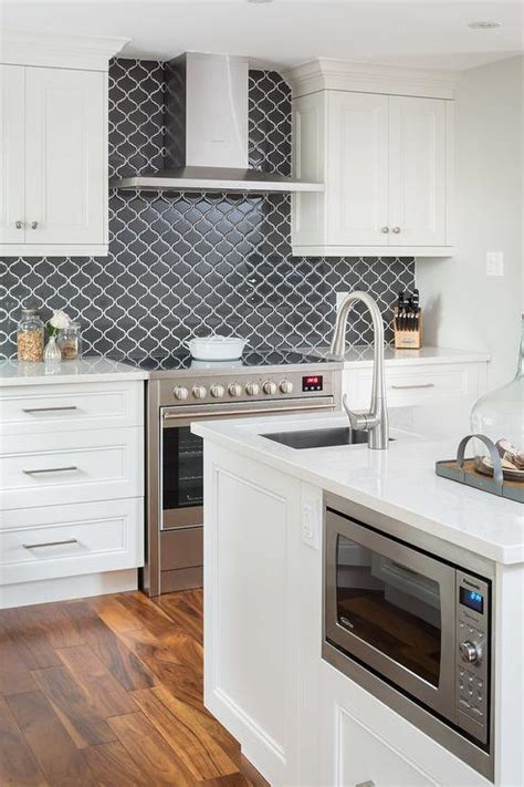 black backsplash in kitchen white kitchen cabinets with black backsplash tiles 4646