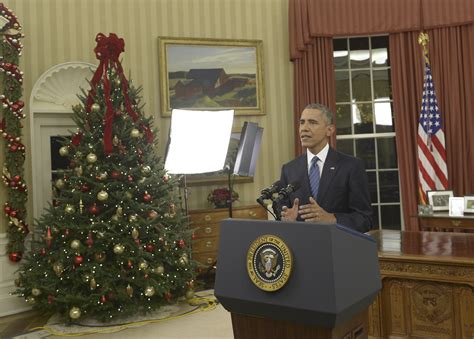 obama in the office president obama addresses nation about terror threat gun