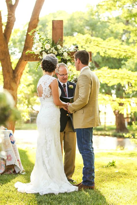 Outdoor Christian Wedding Ceremony With Floral Cross