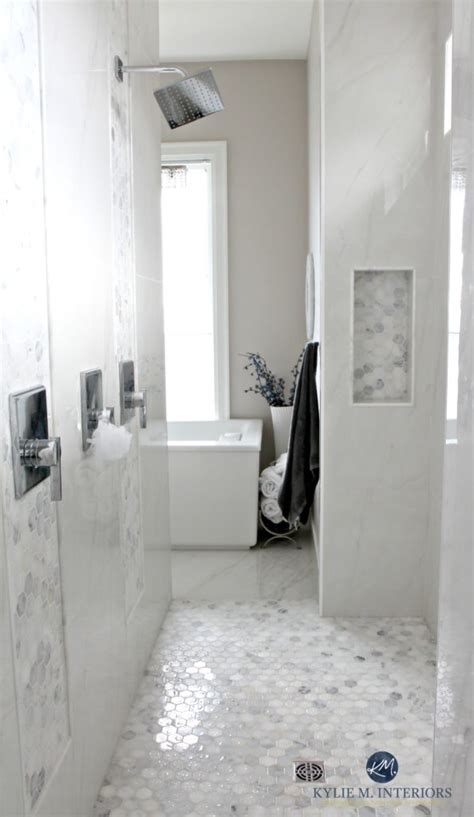 bathroom with marble walk in shower hexagon tile floor