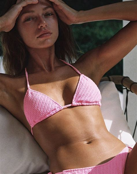 A textured pattern side-tie bikini in bright pink. Fully ...
