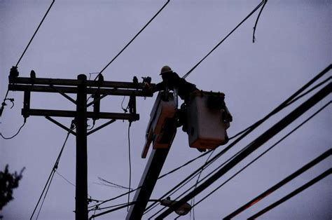 connecticut light power fallen wires utility pole closes road in stamford