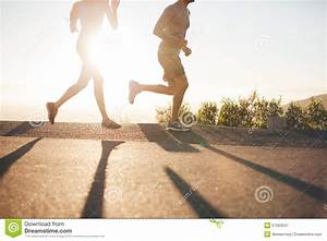 Two People Running On Country Road At Sunrise Stock Image ...