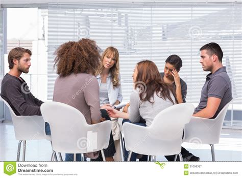 Patients Around Therapist In Group Therapy Session Royalty ...