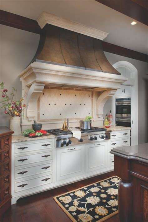 traditional kitchen  white cabinets  dramatic range