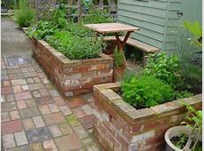 raised garden brick pathway Reclaimed brick raised beds