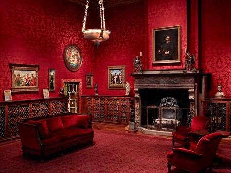 Red Living Room Decor With Antique Fireplace And Victorian