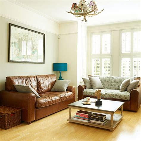 white living room with leather sofas decorating
