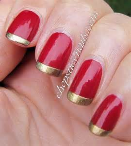 Red nails with gold tip nail art
