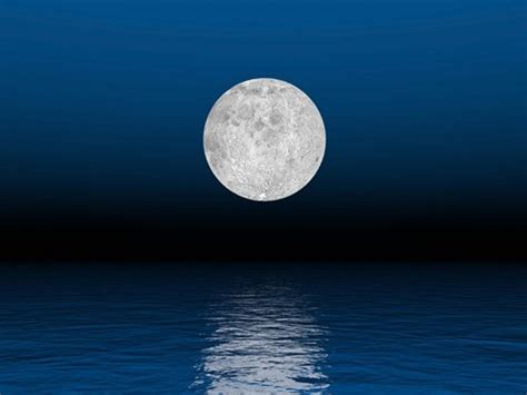beautiful full moon   deep blue sky   ocean