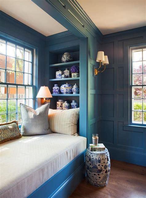 blue paneled den  dark blue built  bookcases