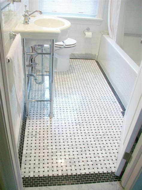 bathroom reno with basketweave floor tile and black border