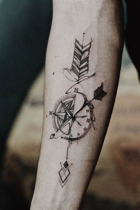 compass arrow tattoo  forearm