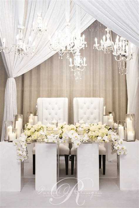 wedding main table decor pristine white head table orchid wedding flowers wedding